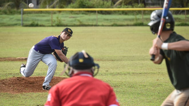 George Washington Geckos' pitcher Alan Gillan checks the movement of his pitch during a shutout performance against the John F. Kennedy Islanders  in an Independent Interscholastic Athletic Association of Guam Boys' Baseball League game in Mangilao on Nov. 18.