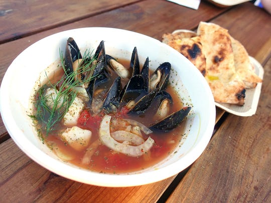 Bouchot mussels and hake with tomato fennel broth and