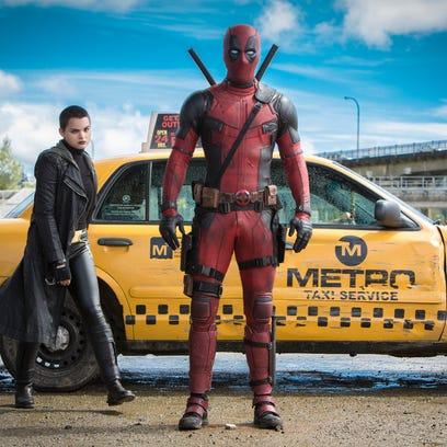 Deadpool (Ryan Reynolds) is ready for battle, joined by Negasonic Teenage Warhead (Brianna Hildebrand).
