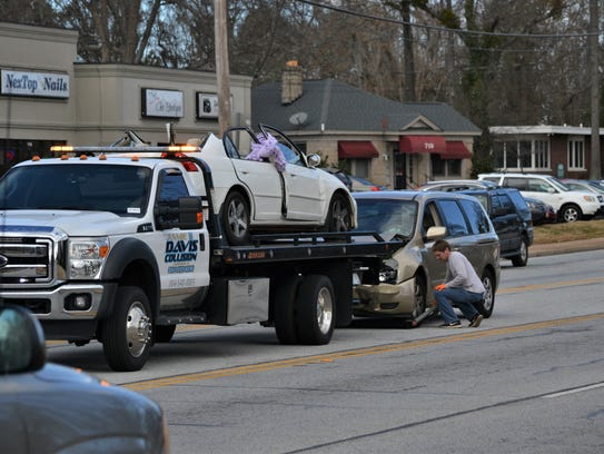 A two-car collision at the corner of East Greenville