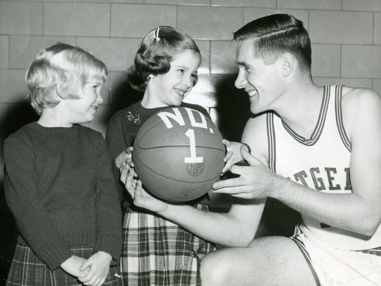 Rutgers' Bob Lloyd poses with children in an undated photo.