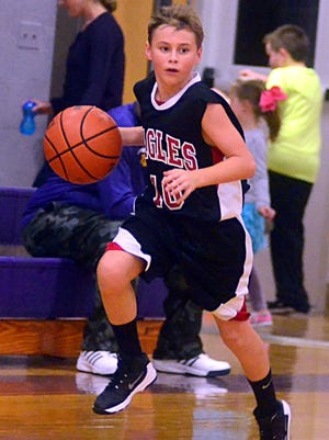 Westmoreland Middle School point guard Dawson Mitchell dribbles the ball up the court during third-quarter action.