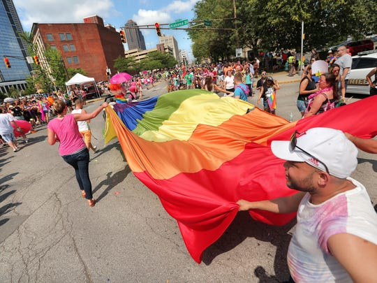 A gay pride flag is carried in last month's Circle City Pride Parade.