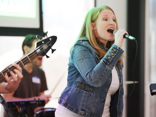 Rebecca Ray sings during Sunday Assembly in Salt Lake City on Sunday, Feb. 11, 2018. Sunday Assembly is a nonprofit group designed to serve atheists, agnostics, humanists and other religiously affiliated adults in Utah.