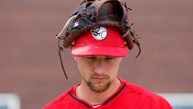 Reds starting pitcher Mike Leake uses his head on Monday in Goodyear.