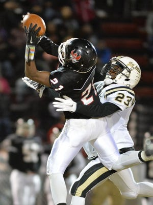 Pearl-Cohn defensive back Greg Hancock (21) intercepts a Springfield pass meant for Dayron Johnson during first-half action on Friday, Nov. 20, 2015.