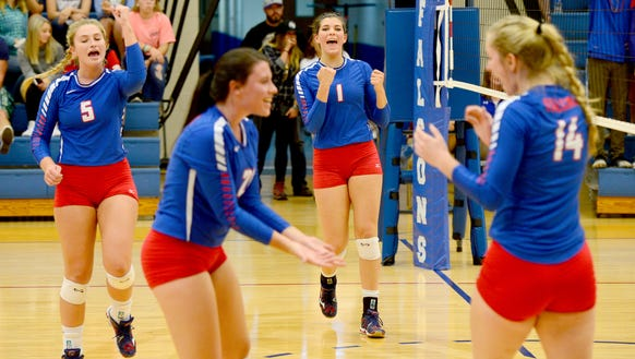 West Henderson players celebrate a point in Saturday's