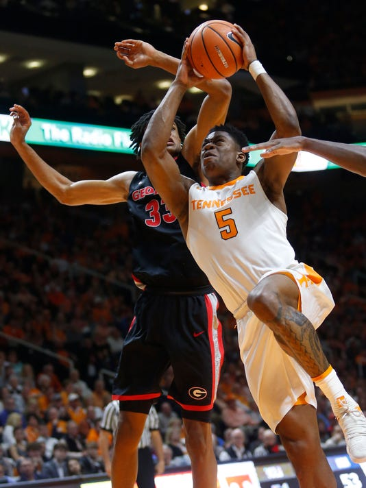 Tennessee forward Admiral Schofield (5) drives as Georgia forward Nicolas Claxton (33) defends during the second half of an NCAA college basketball game Saturday, March 3, 2018, in Knoxville, Tenn. (AP Photo/Crystal LoGiudice)