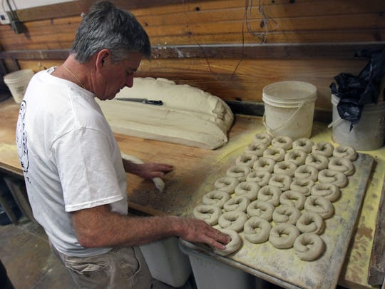 Dan Grimes, co-owner of The Hot Bagel Bakery in Oakhurst, shapes freshly made dough into bagels.