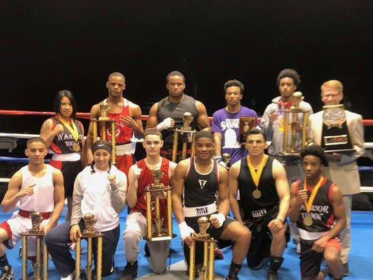 Heavyweight state champion Carnell Giles (back middle) stands with the other Michigan Golden Gloves State champions