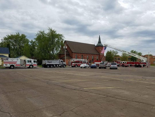 Fire service and highway trucks line up outside Immanuel