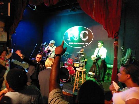 The crowd dances as musicians perform at F. Jones Corner