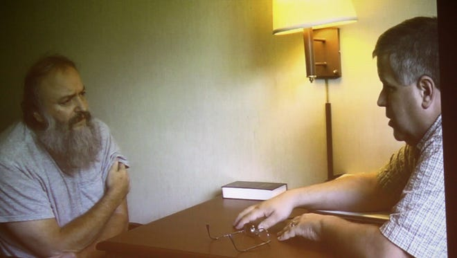 Monroe police Detective Gregg Myers interviews Daniel French, who is charged in the 2012 death of an 87-year-old woman. This image is from a video played in court.