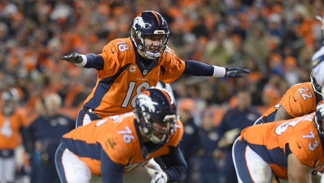 Broncos quarterback Peyton Manning audibles at the line of scrimmage against the Chargers at Sports Authority Field at Mile High.