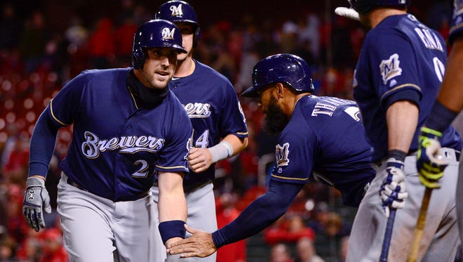 Travis Shaw (left) is congratulated by teammates after hitting a home run in the 10th inning.