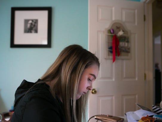 Maddie Heeney studies in her room.