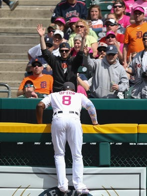 Tigers leftfielder Justin Upton watches a grand slam