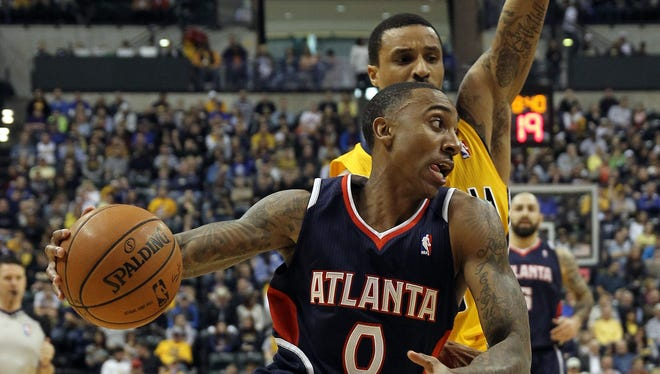 Apr 6, 2014; Indianapolis, IN, USA;  Atlanta Hawks guard Jeff Teague (0) drives to the basket with Indiana Pacers guard George Hill (3) defending during the first quarter at Bankers Life Fieldhouse. Mandatory Credit: Pat Lovell-USA TODAY Sports