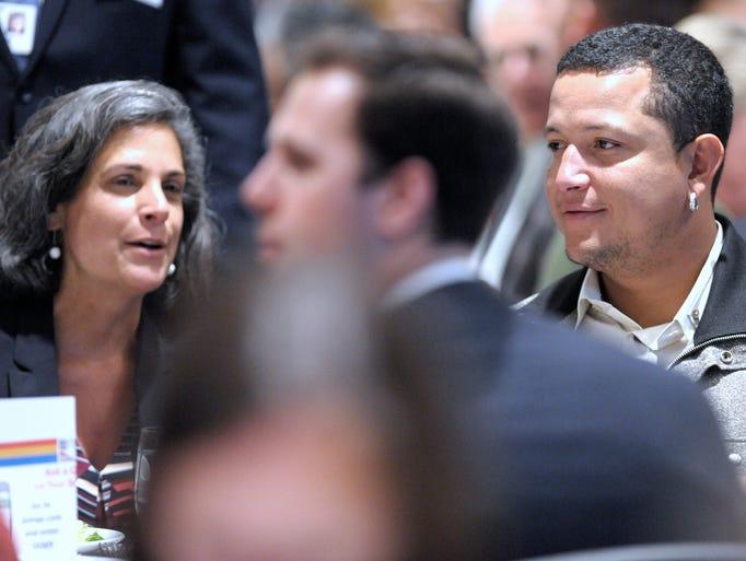 Tigers slugger Miguel Cabrera, right, talks with Deloitte