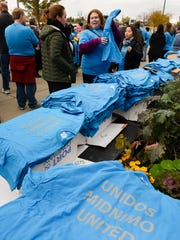 Organizers handed out shirts with UNITED printed in English, Spanish and Somali before a unity walk Saturday in St. Cloud. The group went from the St. Cloud Library to the Stearns County Courthouse.