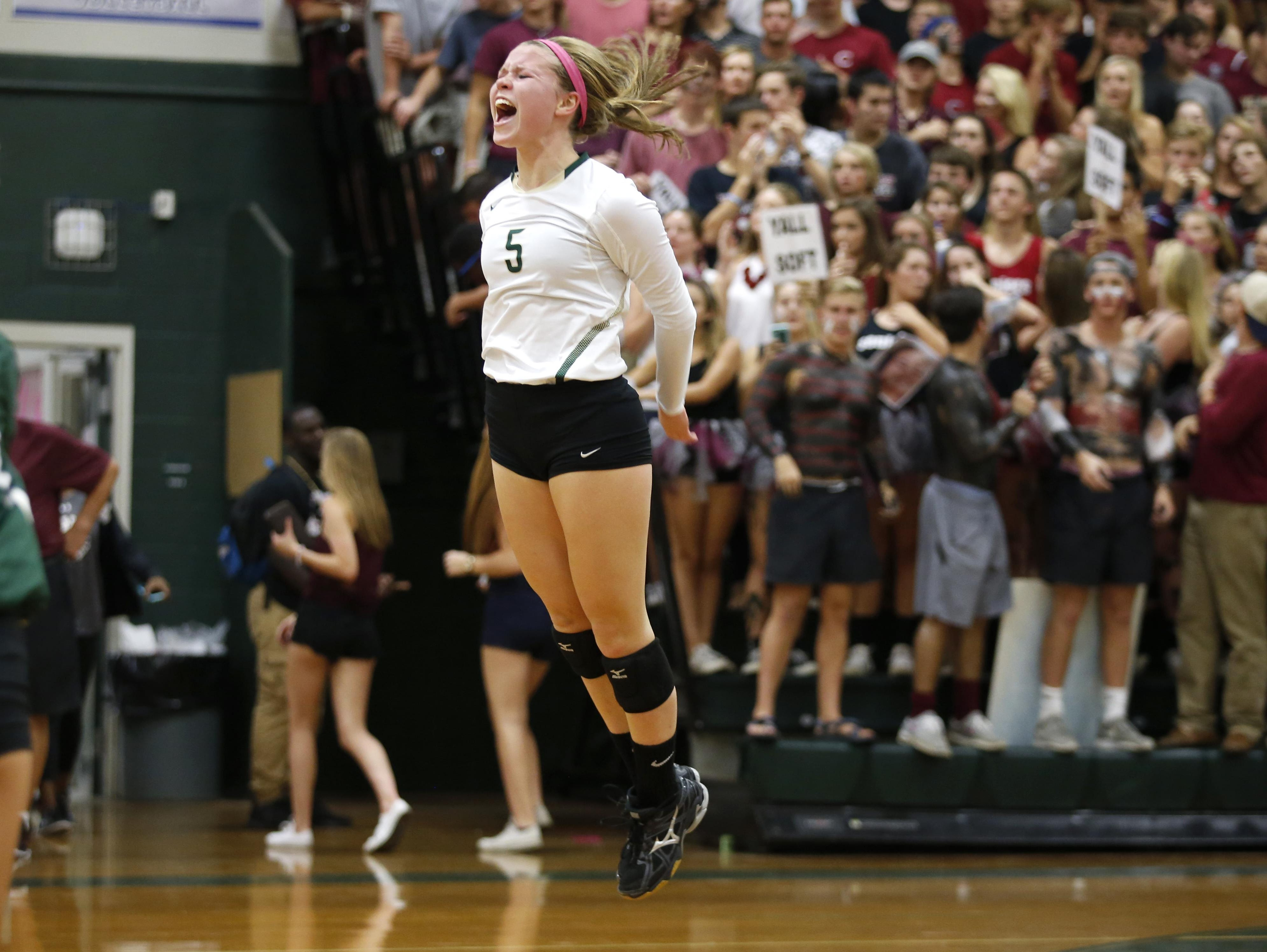 Lincoln's Katie Seccombe celebrates after scoring a point on a serve against Chiles during their match at Lincoln High School on Tuesday. The Trojans picked up an important 3-2 district win.