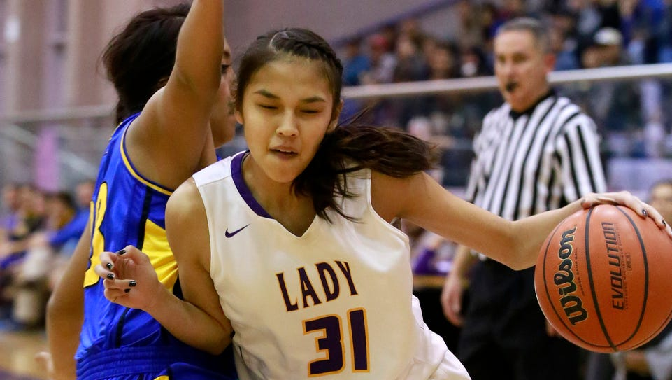 Kirtland Central's Tiajhae Nez drives past Bloomfield's