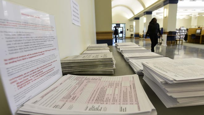 Several tax forms fill a table at the Broome County Public Library in Binghamton.