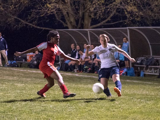 Cumberland Valley Christian's Imani Harper tries to steal the ball from Sarah Preist of Shalom Christian Academy during a girls soccer game on Thursday, April 14, 2016. Shalom defeated Cumberland Valley Christian 5-2.