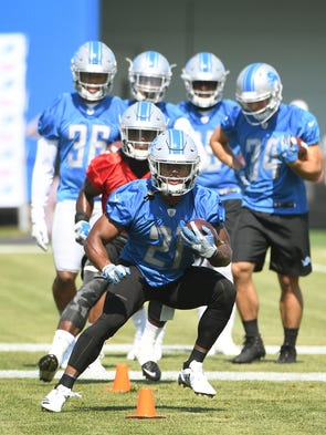 Running back Ameer Abdullah, with Theo Riddick and