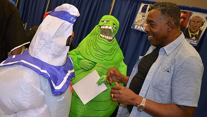 Actor Ernie Hudson visits with Comic Con enthusiasts Patty Welch (Slimmer) of Pearl and Addison Byrd (Marshmallow Man) of Forest during the 2016 Comic Con held Saturday at the Mississippi Trade Mart.