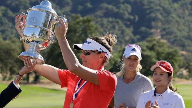 Brittany Lang lifts her trophy after winning the U.S. Women's Open golf tournament at CordeValle Sunday in San Martin, Calif. Anna Nordqvist, center,  who finished second and Hye-Jin Choi, right, look on.