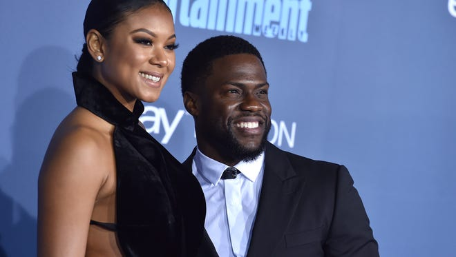 Kevin Hart and Eniko Parrish arrive at the 22nd annual Critics' Choice Awards in Santa Monica on Dec. 11. Hart and Parrish announced on May 14 that they are expecting their first child together.