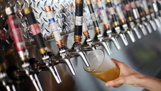 Tap handles are made from old electrical fuses. Owned by electricians Ryan Bennett and Monte Baker, 2 Sparky's Taphouse and Brew Supplies is the latest beer tap house to open in the area.