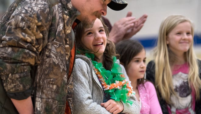 Keira Tittle, 10, of Huntingdon, talks to her father, Travis Tittle, on Wednesday, April 4, 2018, after her Make-A-Wish trip to Hawaii was revealed by Huntingdon High School students.
