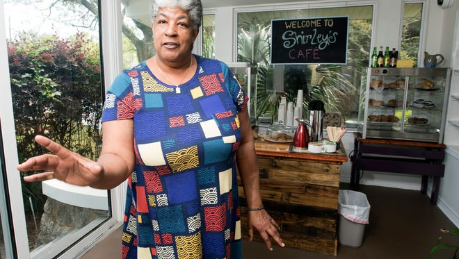 Shirley Hughes, the owner of Shirley's Speciality Cafe and Bakery, describes her variety of menu items Friday, April 27, 2018. The new eatery in East Hill offers locally-roasted coffee, scratch-made pastries, and bread, as well a variety of traditional and vegan-friendly sandwiches.