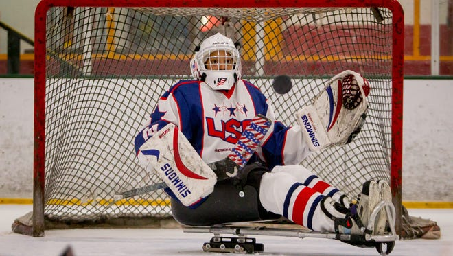 Gabby Graves-Wake, a goalie for the United States National Women's Sled Hockey team, blocks a shot during a practice on Monday, June 11, 2018, at AZ Peoria Ice in Peoria, Phoenix.