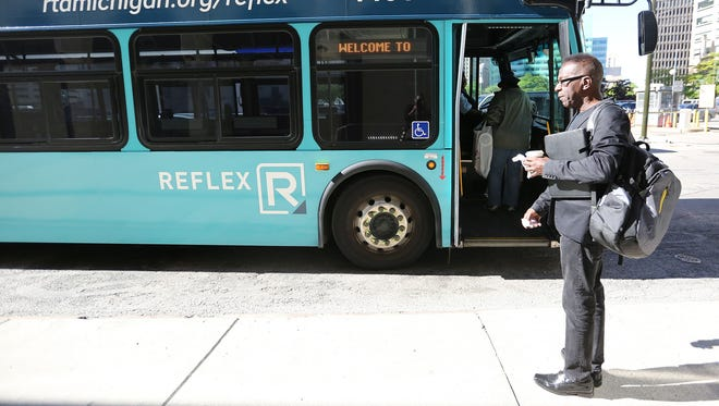 John Collins of Detroit's West Village prepares to board the Reflex, a new express bus service from downtown Detroit on Monroe to his office at Underground Resistance, the world's only techno museum, off of Woodward at 3000 E. Grand Blvd.