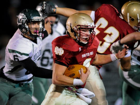 Mater Dei's Chase Rheinlander (9) runs the ball past Monrovia's Aaron Cravens (6) during their Class 2A regional game at the Reitz Bowl in Evansville, Friday, Nov. 11, 2016.