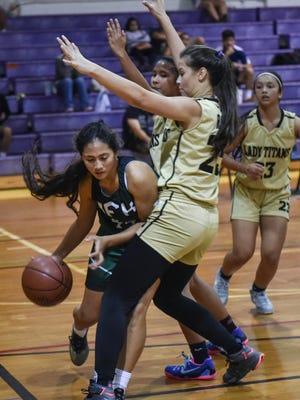 The John F. Kennedy Islanders' played the Tiyan Titans in an Independent Interscholastic Athletic Association of Guam Girls' Basketball League match at George Washington High School on Dec. 1.