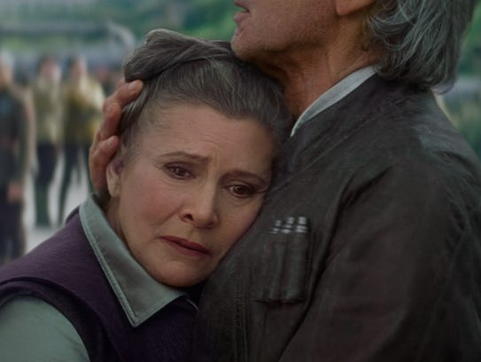 Leia (Carrie Fisher) and Han Solo (Harrison Ford) reconnect