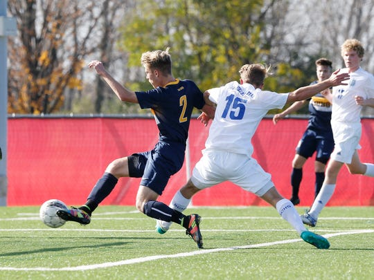 Marquette's Joel Migliaccio scores in the first half of the Division 1 state tournament match against Brookfield Central on Nov. 3, 2016, at Kohler Engines Uihlein Soccer Park.
