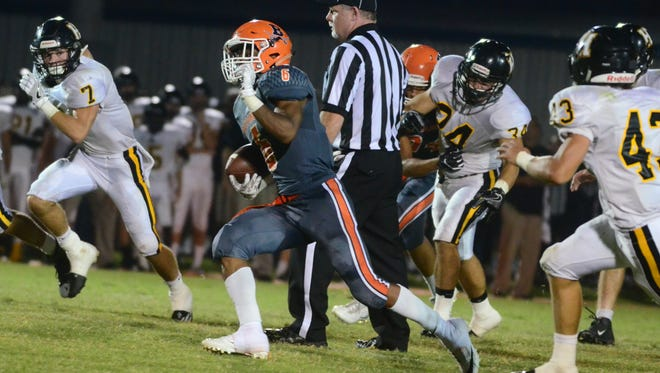 Beech senior Alex Vanzant cuts through the Hendersonville defense during Friday's contest. Vanzant had 117 yards on 23 carries in the Buccaneers' 24-23 victory.