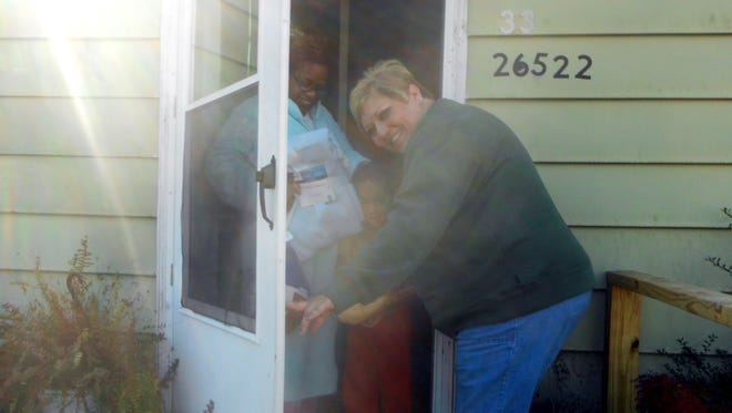 CJ Cole delivers one of the 200 boxes of food distributed by the the many volunteers of the Bank of Cheer in 2011.