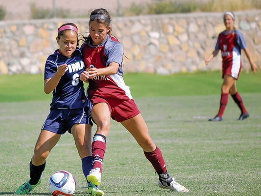 New Mexico State's Aileen Galicia fights for possession against Pima Community College player Mauri Delgadillo during the Aggies 2-0 exhibition game victory on Wednesday at the NMSU Soccer Complex. The Aggies won on goals from Dominique Rivera and Holly Abdelkader. NMSU opens the season on Sunday at 1 p.m., against Eastern Washington at home.   Photo by Jeremy Perlman for the Sun-News
