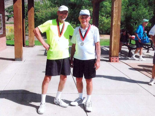 Fred Ehrlich, left, of York, and Art Barnes, right, of Littlestown, pose with their gold medals at the Huntsman Senior World Games in St. George, Utah. The pair won the men's 75-79 doubles tennis division.