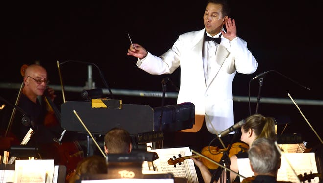 Conductor Daniel Hege leads the Binghamton Philharmonic at Pops on the River on Thursday.