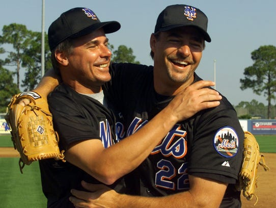 New York Met's pitcher Al Leiter, right, laughs it