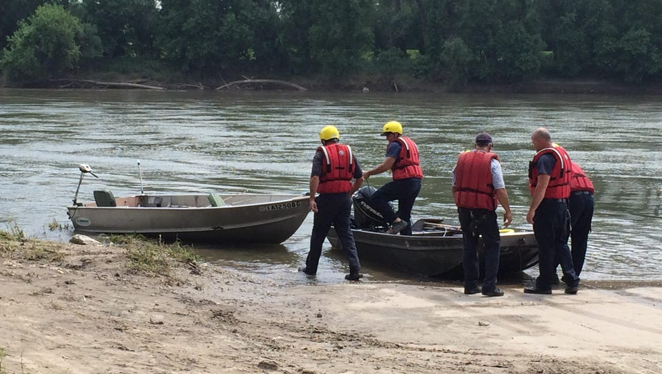 Des Moines Fire Department officials haul a stray fishing