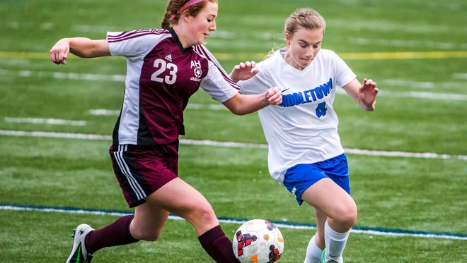 Appoquinimink's Abbe Power (left) and Middletown's Shannon Gamble (right) jockey for position on the ball in the first half of Middletown's 1-0 win over Appoquinimink at Cavalier's Stadium in Middletown on Wednesday evening.
