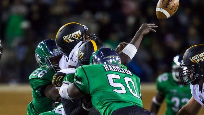 Southern Miss quarterback Keon Howard gets sacked by North Texas linebacker LaDarius Hamilton on Saturday at Apogee Stadium in Denton, Texas.